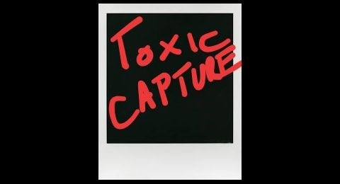 "A polaroid photo with the words ""toxic capture"" written over top"